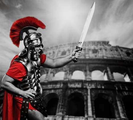 roman soldier: Roman legionary soldier in front of coliseum Stock Photo