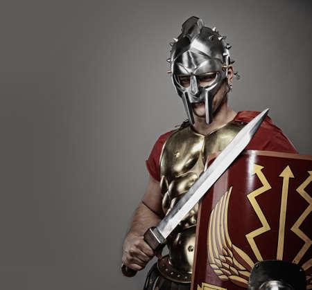 warrior sword: Legionary soldier ready for a war