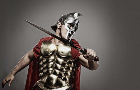 gladius: Legionary soldier ready for a fight Stock Photo