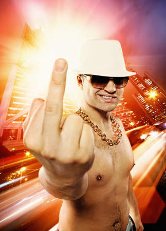 pimp: Man showing middle finger in front of night city