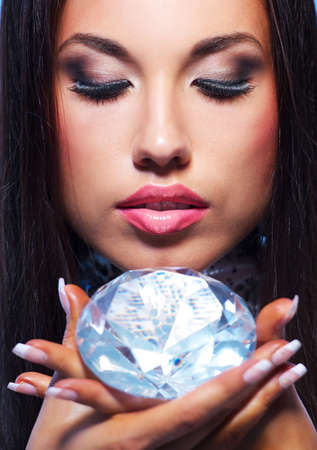 Close-up portrait of a beautiful woman with a diamond photo