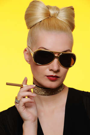 Beautiful charming lady with a cigarette photo