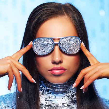 blue sexy: Brunette woman in stylish sunglasses