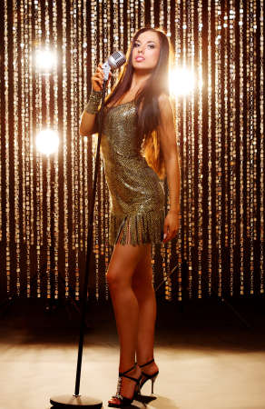 microphone stand: Attractive singer on the stage