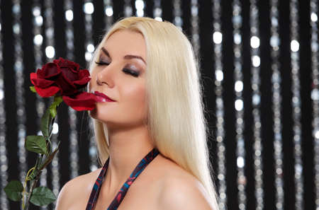 Beautiful blond woman with a rose photo