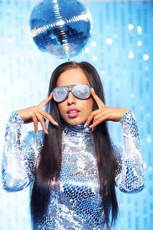 Stylish dancing woman in the club photo