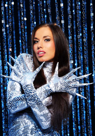 Beautiful brunette with long nail gloves Stock Photo - 8131752