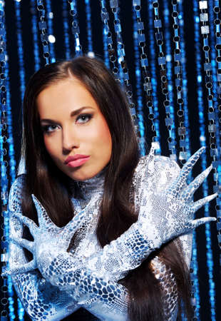 Beautiful brunette with long nail gloves photo