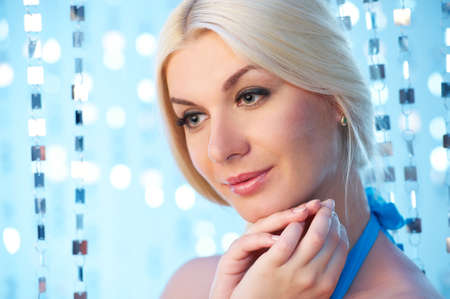 Beautiful blond woman over abstract blue background Stock Photo - 8131703