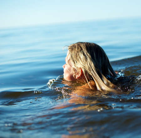 Girl swimming in the water photo