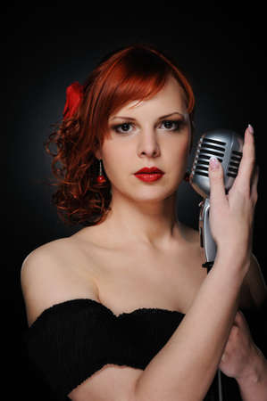 Beautiful singer with a microphone photo