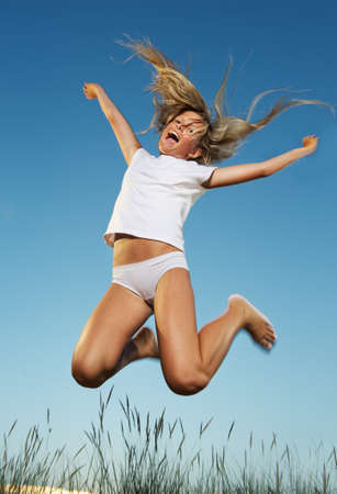 vocation: Happy little girl jumping Stock Photo