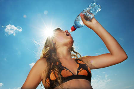 Young girl drinking water outdoors Stock Photo - 8131721