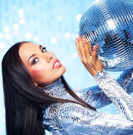 Beautiful brunette with disco ball photo