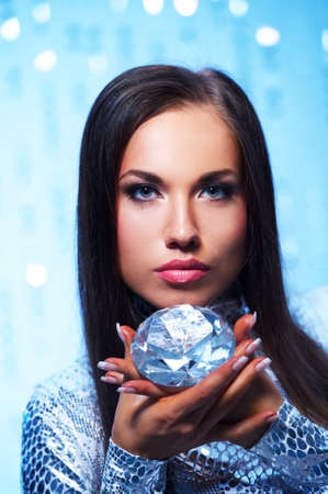 Beautiful brunette with diamond photo