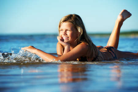 Happy girl lying in the water Stock Photo - 8953742