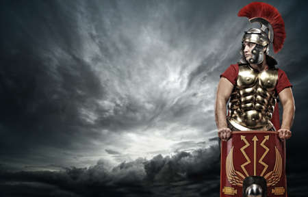 Legionary soldier over stormy sky photo