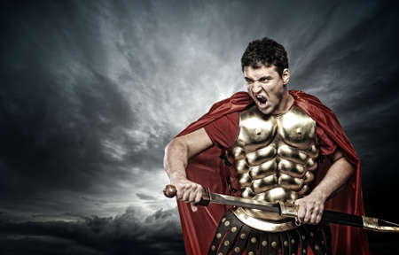 ancient warrior: Legionary soldier over stormy sky Stock Photo