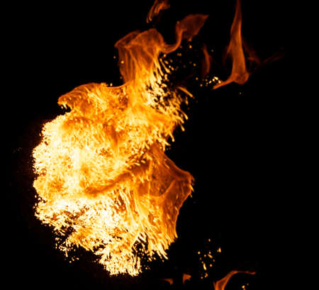 gas fire: Fire explosion isolated on black background Stock Photo