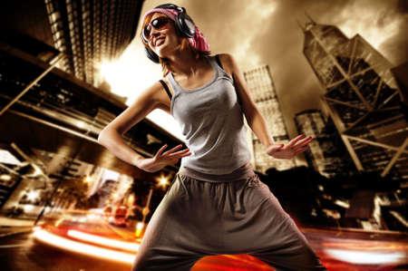 Beautiful dancing girl on a street photo