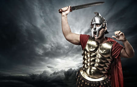gladiator: Legionary soldier over stormy sky Stock Photo