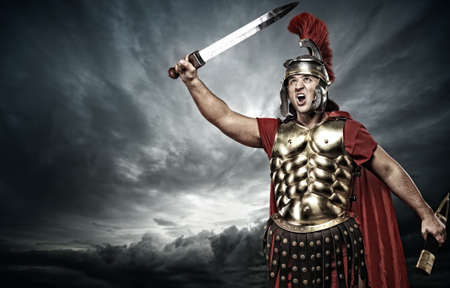 roman soldier: Legionary soldier over stormy sky Stock Photo