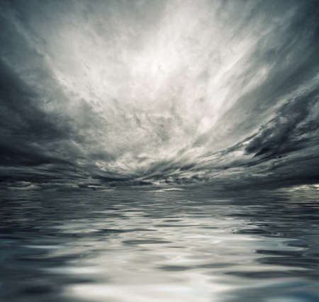 storm: Dramatic sky reflected in sea water Stock Photo