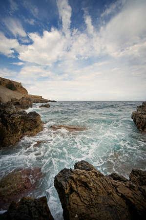 Ocean vawes breaking the rocks photo