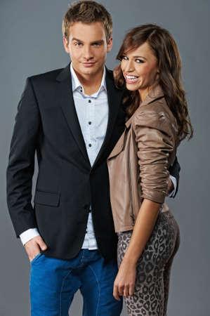 elegant couple: Attractive couple isolated on grey background Stock Photo