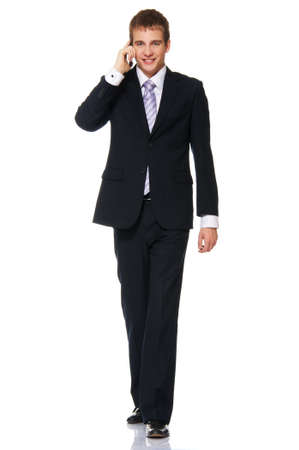 Young businessman talking on mobile phone photo