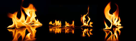 Beautiful stylish fire flames reflected in water photo