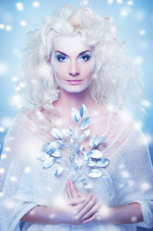 Snow queen with a magic twig photo