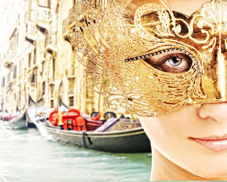 Woman with carnival mask in Venice photo