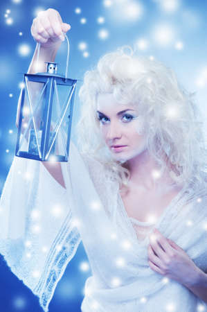Snow queen with a latern    photo