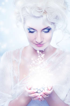 snow girl: Beautiful snow queen with a christmas decoration Stock Photo