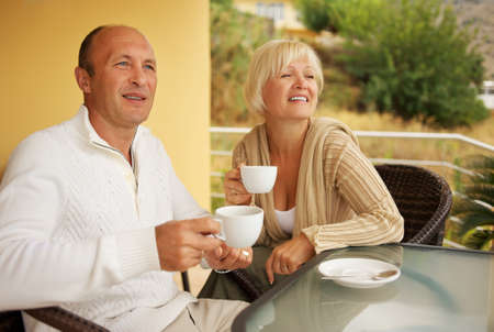 caffee: Middle-aged couple drinking caffee outdoors