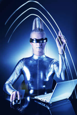 Beautiful cyber woman pointing at something   photo