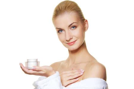 facial cream: Woman applying moisturizer cream on her body