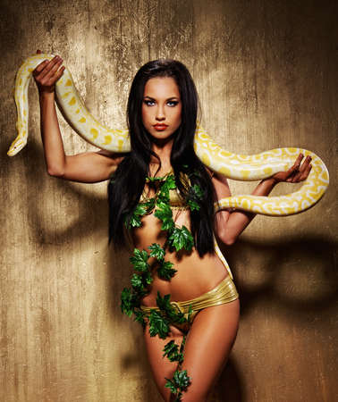 exotic woman: Attractive brunette woman with python
