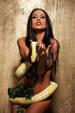 Attractive brunette woman with python Stock Photo - 9008554