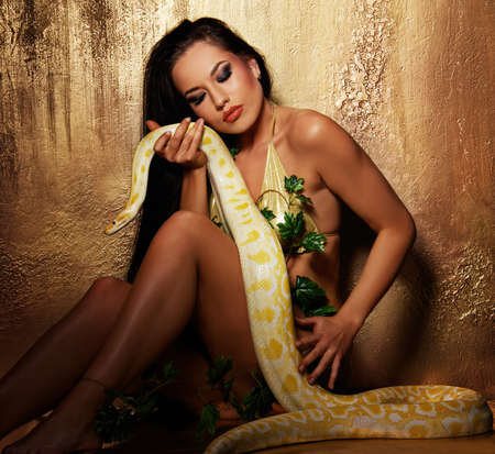 Attractive brunette woman with python photo