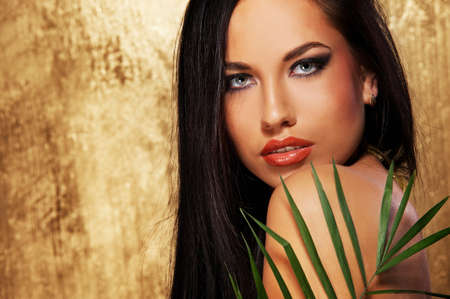 exotic plant: Close-up portrait of an attractive brunette woman Stock Photo