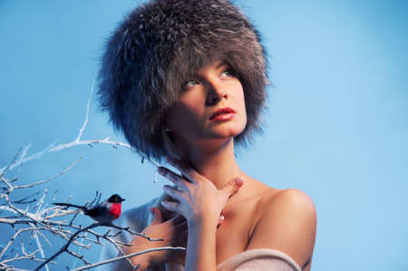 fur tree: Attractive woman in winter forest