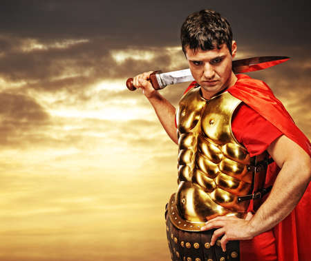 Roman legionary soldier against cloudy sky photo
