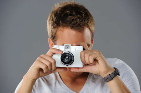 Young man with a camera photo