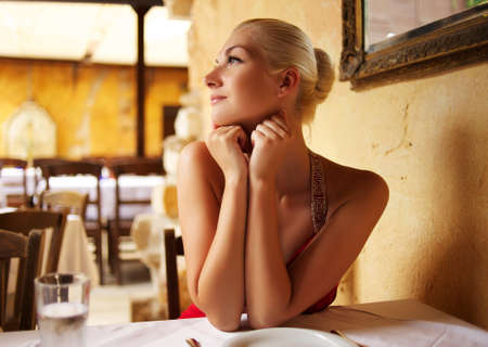 Beautiful woman in a restaurant photo