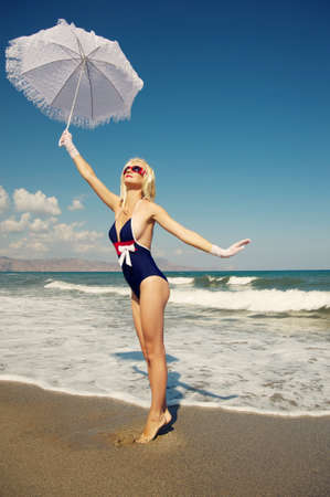 Attractive blond woman in the sea photo