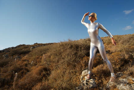 Cyber woman in the mountains photo