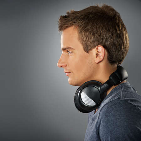 Young man with a headphones photo