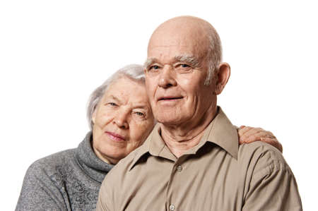 Portrait of a happy senior couple embracing each other photo